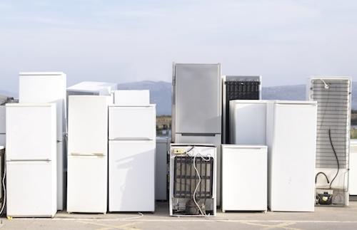 Old fridges freezers refrigerant at refuse dump skip recycle plant help environment