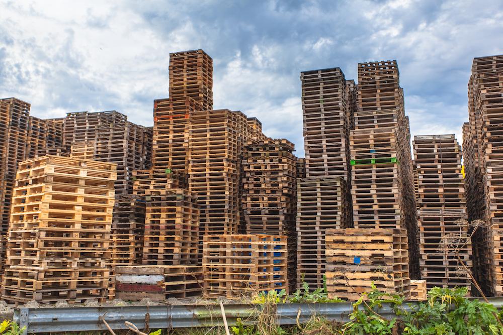 Stacks of Wooden Transportation Pallets