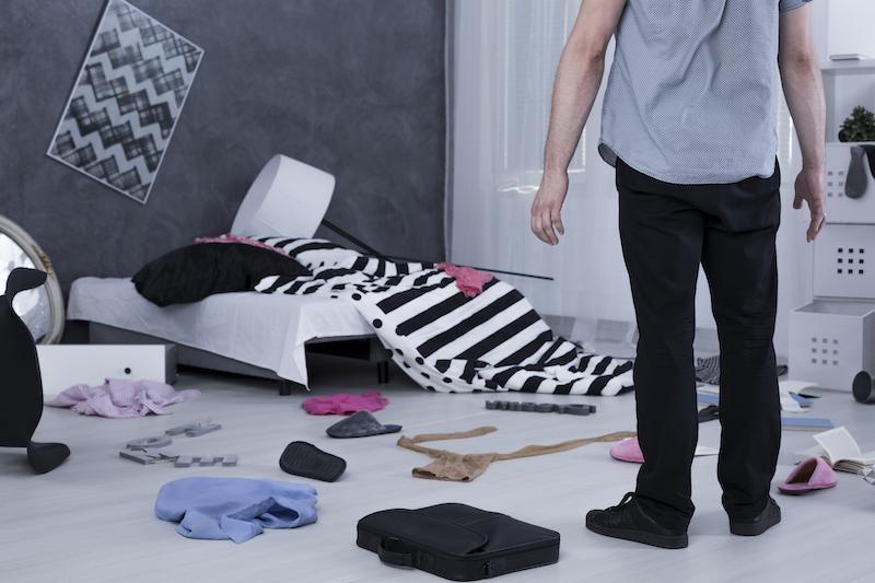 Surprised man in messy room