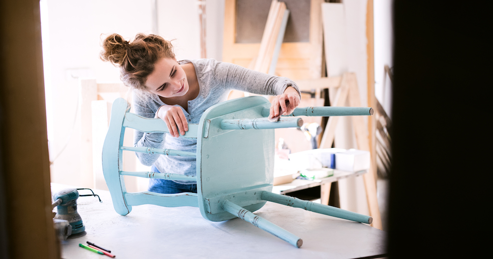 young woman upcycling chair