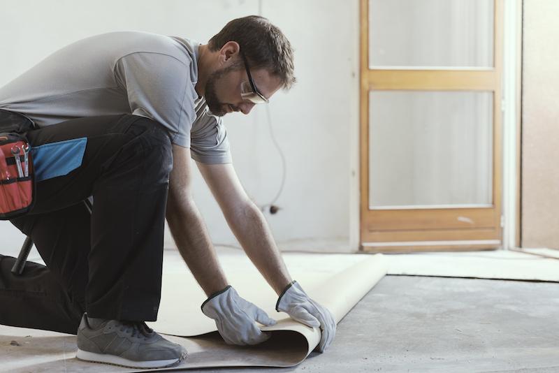 Contractor removing an old linoleum flooring