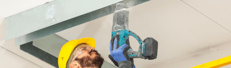 worker removing plasterboard