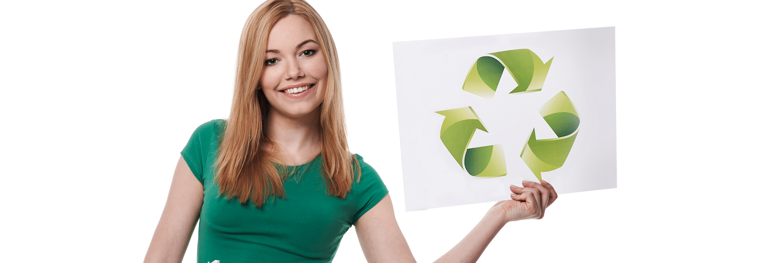 girl holding recycle sign