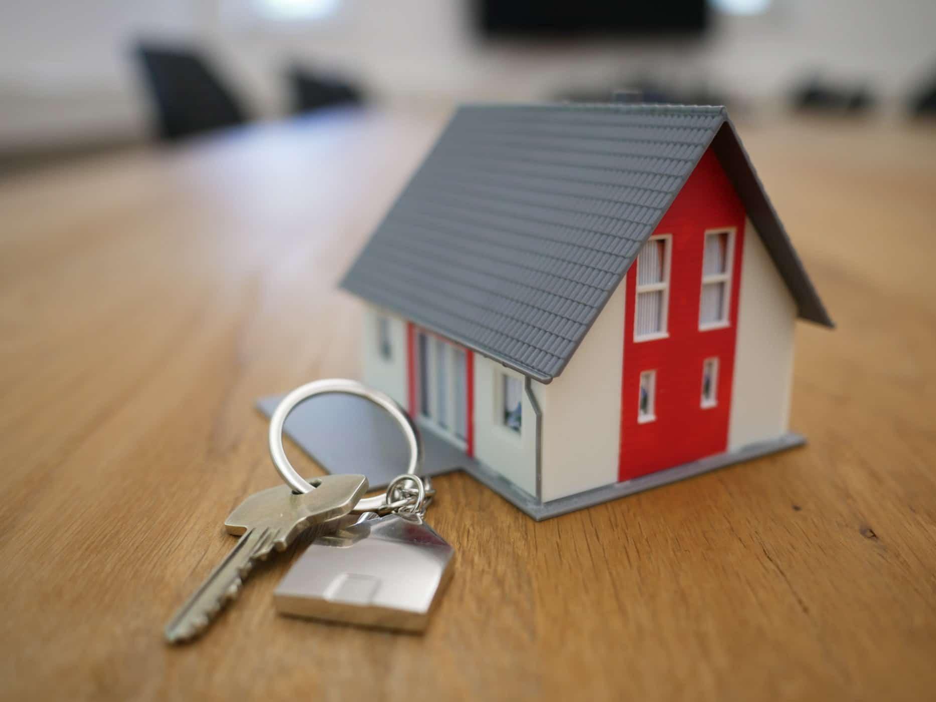 a miniature house and a key