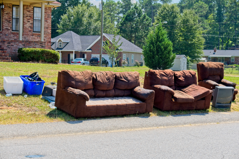 Unwanted and discarded furniture sitting on the side of road