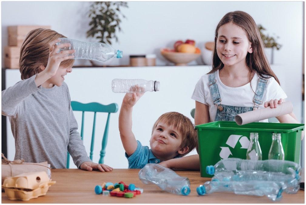siblings having fun recycling