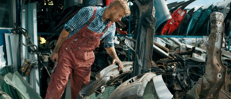 Male man looking at scrape metal